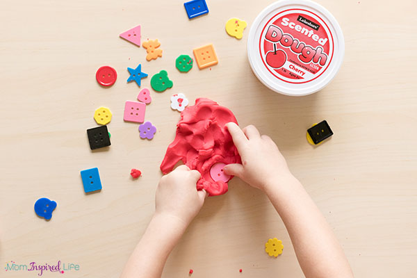 Play dough and buttons fine motor activity for preschoolers.