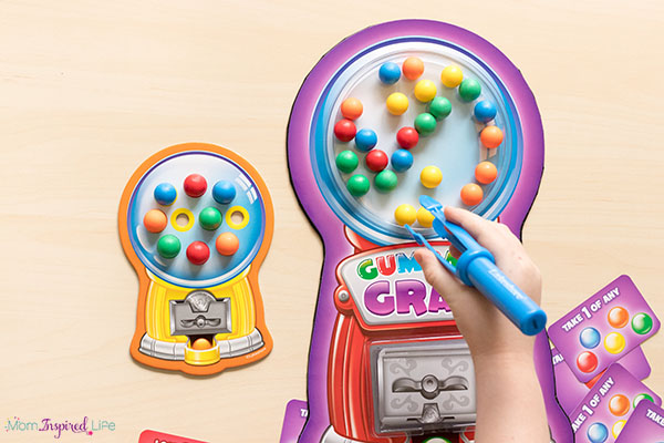 Gumball Grab fine motor game for preschool. A fun way to develop fine motor skills!