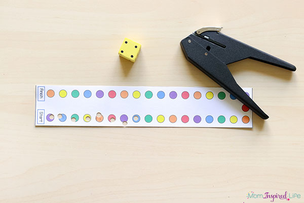 Fine motor hole punch game for kids. Develop fine motor skills while learning to count!