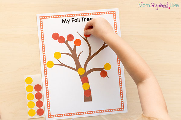 Preschool fall craft that uses dot stickers to develop fine motor skills while creating art!