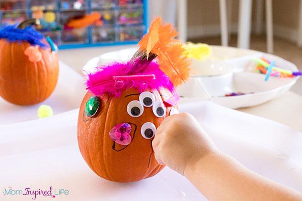 Decorating pumpkins craft activity for preschoolers.