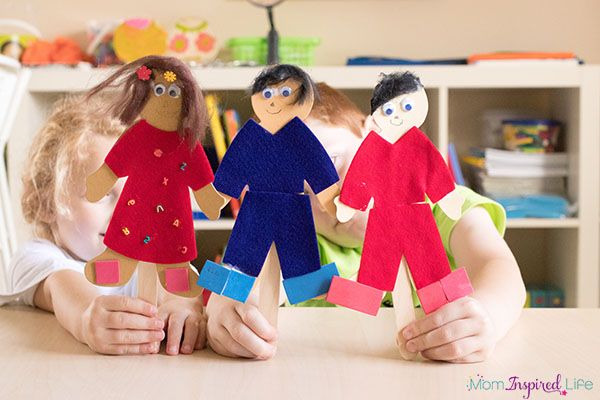 Multicultural paper doll puppet craft.
