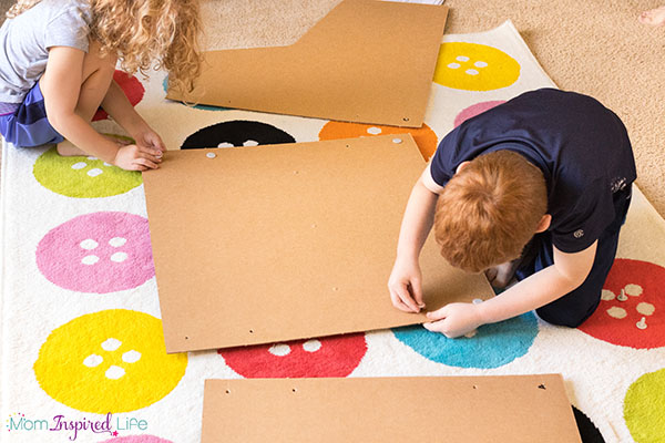 Cardboard ski-ball project that kids can help build. This STEM activity is so much fun!