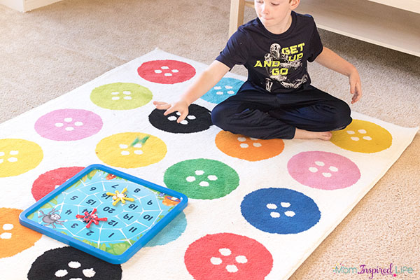 Bug toss carnival game that teaches the alphabet and number sense.