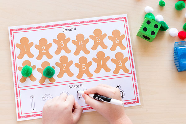 Christmas roll and cover math centers for Kindergarten or preschool. A Christmas number sense activity.