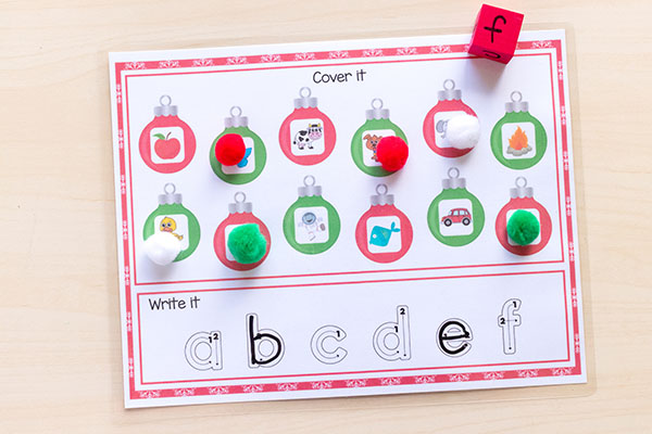 Christmas roll, cover and write mats are a great way for kids to learn math and literacy skills this holiday season.