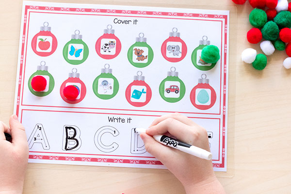 A Christmas literacy activity that teaches letters, letter sounds and tracing or writing letters.