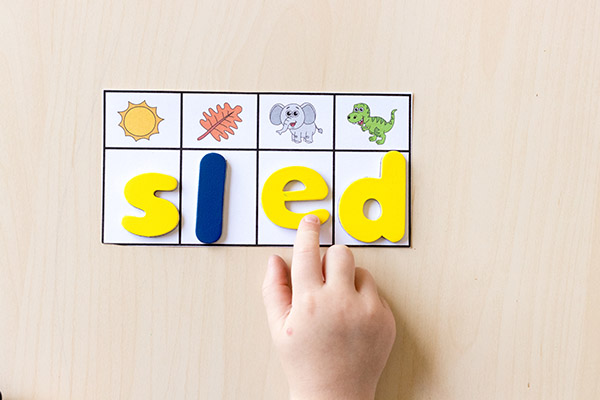 Building seasonal words with magnetic letters.