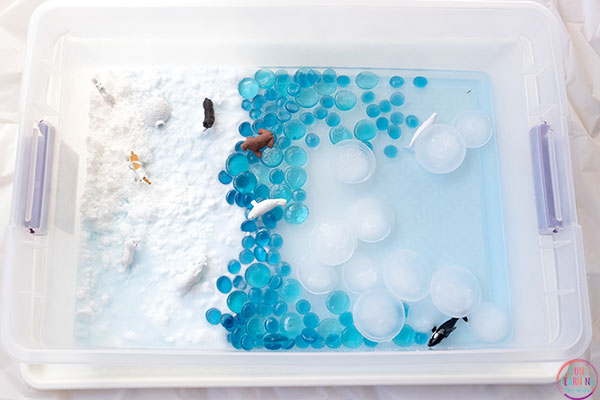Arctic habitat sensory bin with snow dough, ice and water.