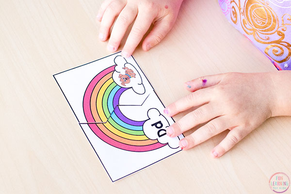 Learning beginning sounds with fun rainbow puzzles.