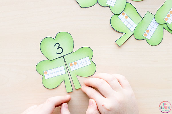 Shamrock puzzles that teach addition within 10.