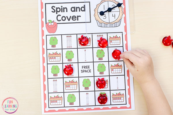 This apple spin and cover math game is perfect for kindergarten and pre-k. Add it to your math centers for lots of fun and effective learning.