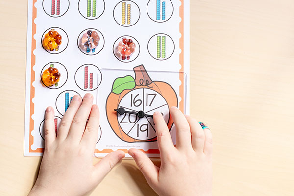 These pumpkin spin and cover games are so fun and perfect for math and literacy centers!