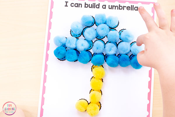 Spring fine motor mats for developing fine motor skills with pom poms in preschool and kindergarten.