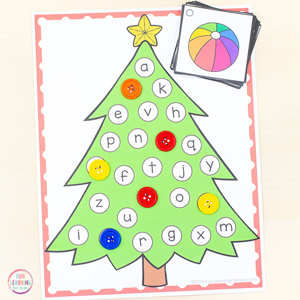 Christmas tree printable mat with alphabet letters all over the tree.