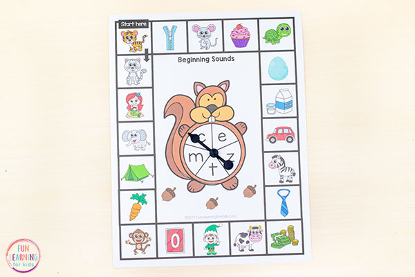 Forest theme alphabet board game with beginning sounds pictures and a squirrel spinner.