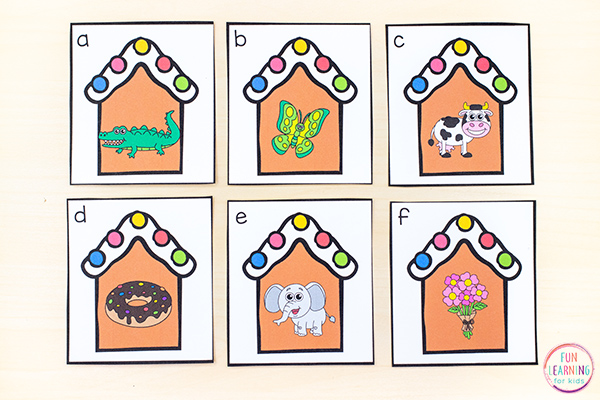 Gingerbread beginning sounds alphabet write the room activity with gingerbread house cards.
