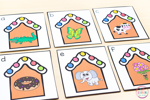 Gingerbread house cards with beginning sounds pictures on them.