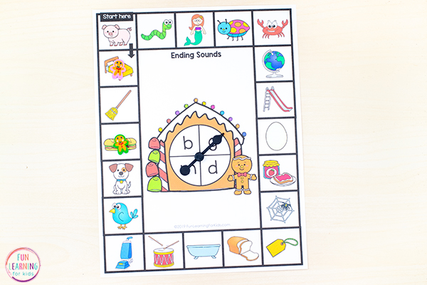 A phonics board game with gingerbread house spinner in the middle.
