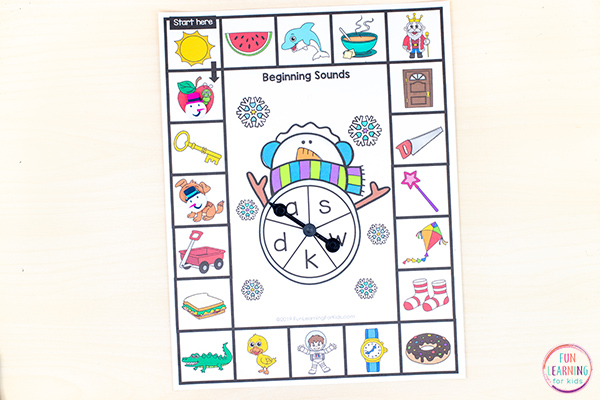 Snowman winter literacy activity board games for learning beginning, middle, and ending sounds.