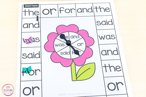 Print and play word work board game with flower theme for spring literacy activities.