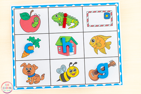 Alphabet mats with beginning sound pics on mat. Students place letter magnets on corresponding beginning sounds picture.